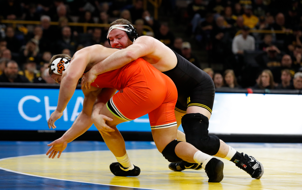 Iowa's Sam Stoll wrestles Oklahoma State's Derek White at heavyweight
