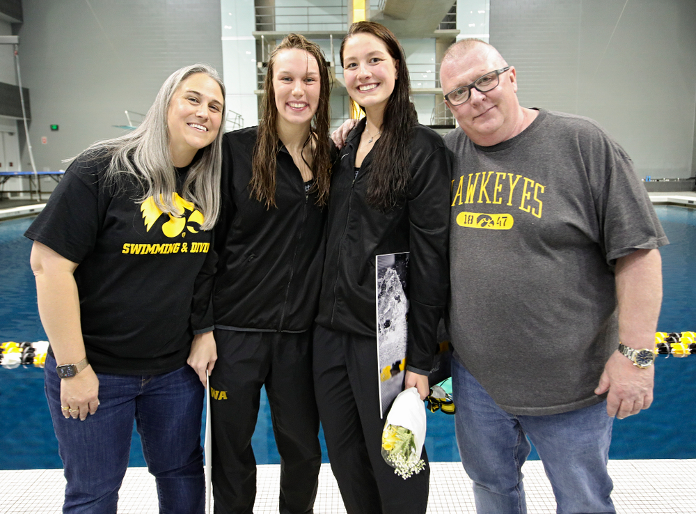 Iowa's Allyssa Fluit (from left) and Hannah Burvill are honored on senior day before their meet at the Campus Recreation and Wellness Center in Iowa City on Friday, February 7, 2020. (Stephen Mally/hawkeyesports.com)