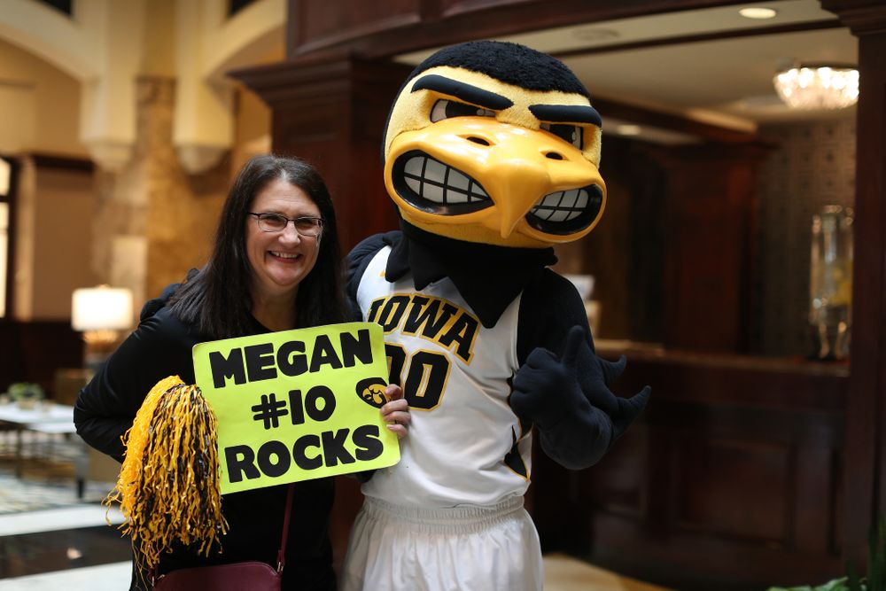 Eva Gustafson and Herky during a send off at the hotel before their game against the NC State Wolfpack in the regional semi-final of the 2019 NCAA Women's College Basketball Tournament Saturday, March 30, 2019 at Greensboro Coliseum in Greensboro, NC.(Brian Ray/hawkeyesports.com)
