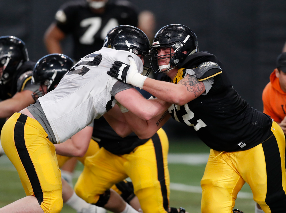 Iowa Hawkeyes offensive lineman Coy Kirkpatrick (72) and Iowa Hawkeyes defensive end Jack Kallenberger (82) during spring practice Wednesday, March 28, 2018 at the Hansen Football Performance Center.  (Brian Ray/hawkeyesports.com)