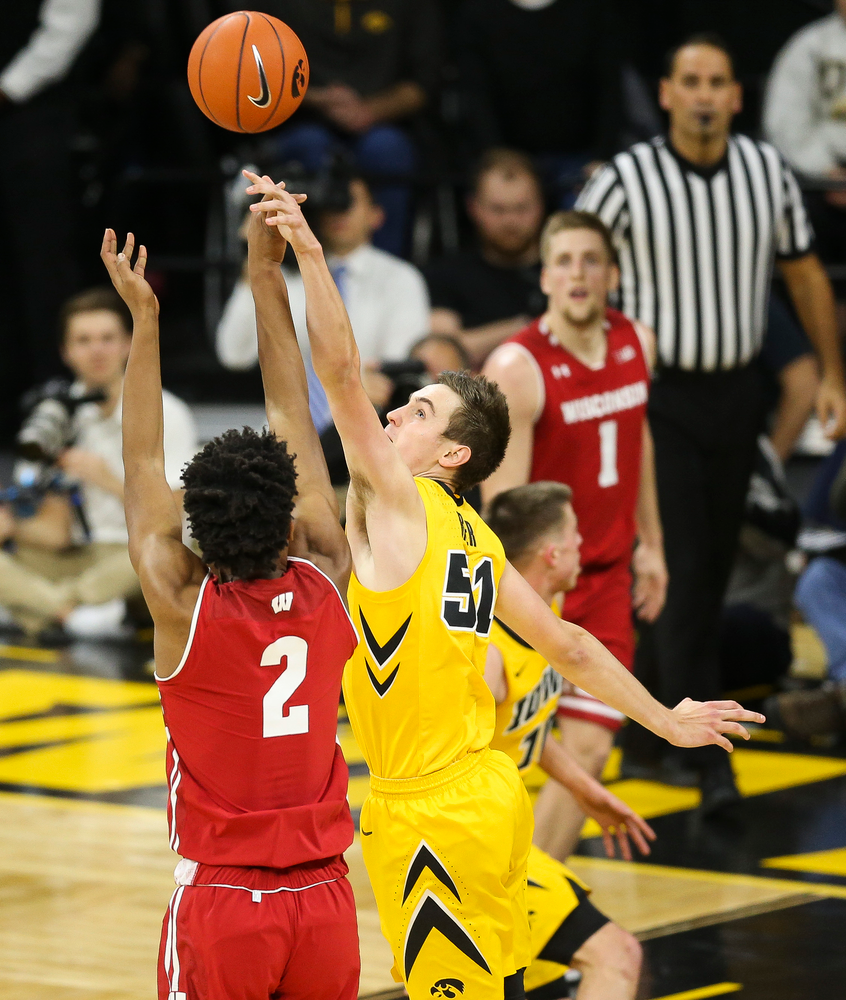 Iowa Hawkeyes forward Nicholas Baer (51) blocks a shot against Wisconsin on November 30, 2018 at Carver-Hawkeye Arena. (Tork Mason/hawkeyesports.com)