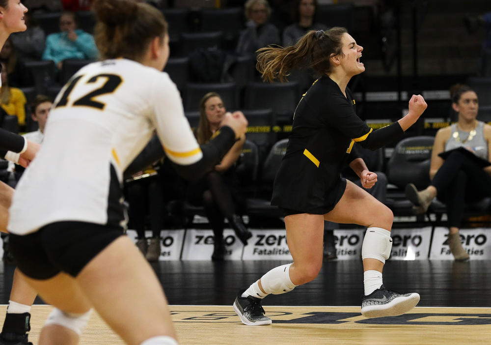 Iowa Hawkeyes defensive specialist Molly Kelly (1) celebrates after winning a point during a match against Maryland at Carver-Hawkeye Arena on November 23, 2018. (Tork Mason/hawkeyesports.com)
