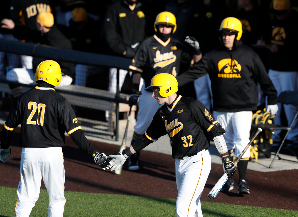 Iowa Hawkeyes catcher Austin Guzzo (20) and catcher Brett McCleary (32) against Grand View Wednesday, April 4, 2018 at Duane Banks Field. (Brian Ray/hawkeyesports.com)