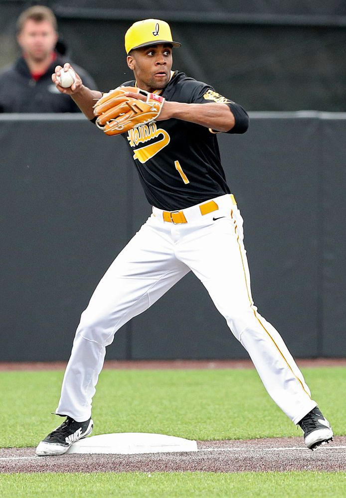 Iowa Hawkeyes third baseman Lorenzo Elion (1) throws to second base to complete a double play during the third inning of their game against Illinois State at Duane Banks Field in Iowa City on Wednesday, Apr. 3, 2019. (Stephen Mally/hawkeyesports.com)