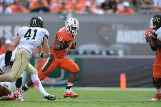 University of Miami Hurricanes running back Duke Johnson #8 plays in a game against the Wake Forest Demon Deacons at Sun Life Stadium on October 26,...
