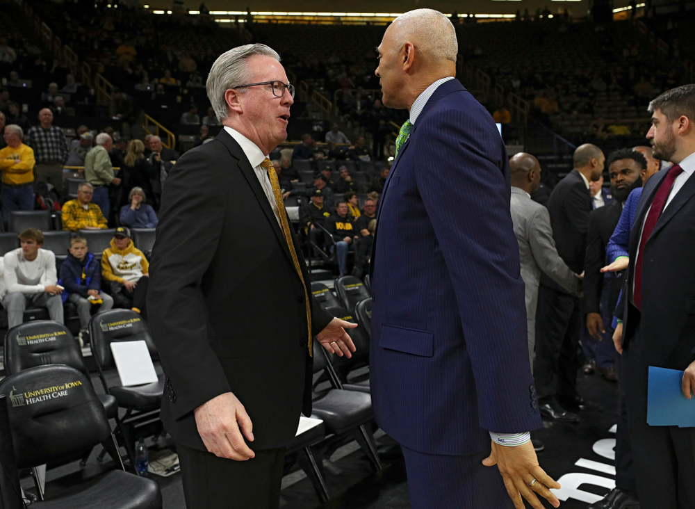 Iowa Hawkeyes head coach Fran McCaffery talks with DePaul head coach Dave Leitao before their game at Carver-Hawkeye Arena in Iowa City on Monday, Nov 11, 2019. (Stephen Mally/hawkeyesports.com)