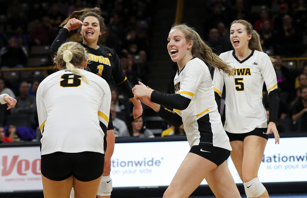 Iowa Hawkeyes middle blocker Hannah Clayton (18) celebrates after winning a point during a match against Maryland at Carver-Hawkeye Arena on November 23, 2018. (Tork Mason/hawkeyesports.com)