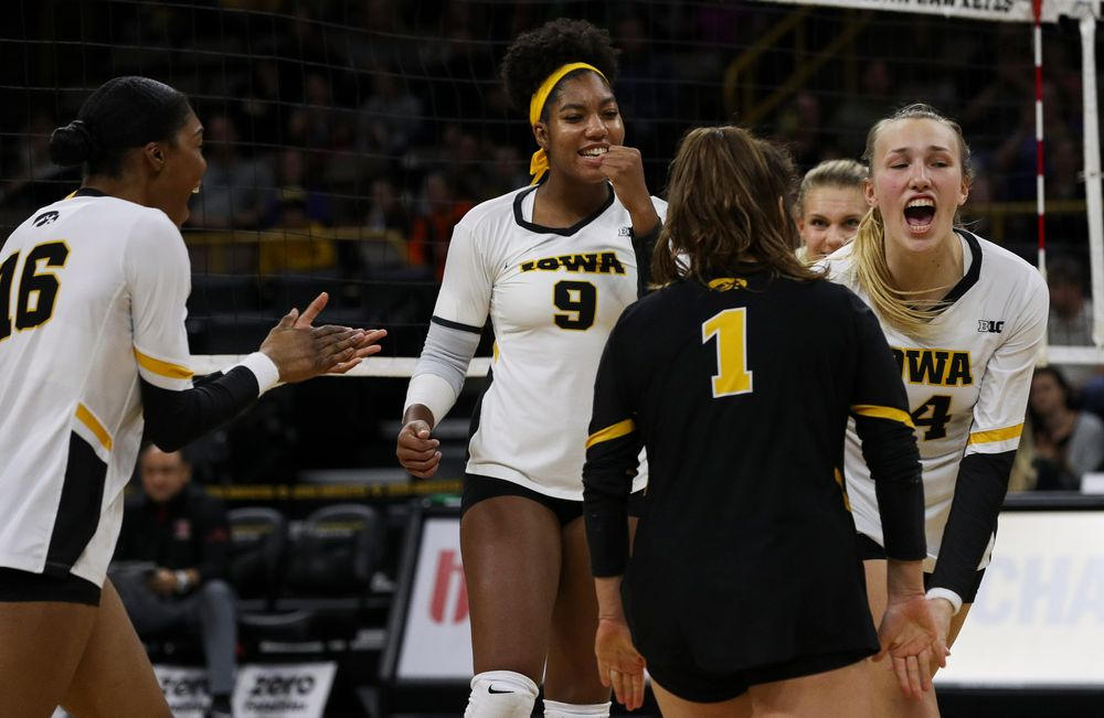 Iowa Hawkeyes middle blocker Amiya Jones (9) and Iowa Hawkeyes outside hitter Cali Hoye (14) celebrate after winning a point during a match against Rutgers at Carver-Hawkeye Arena on November 2, 2018. (Tork Mason/hawkeyesports.com)