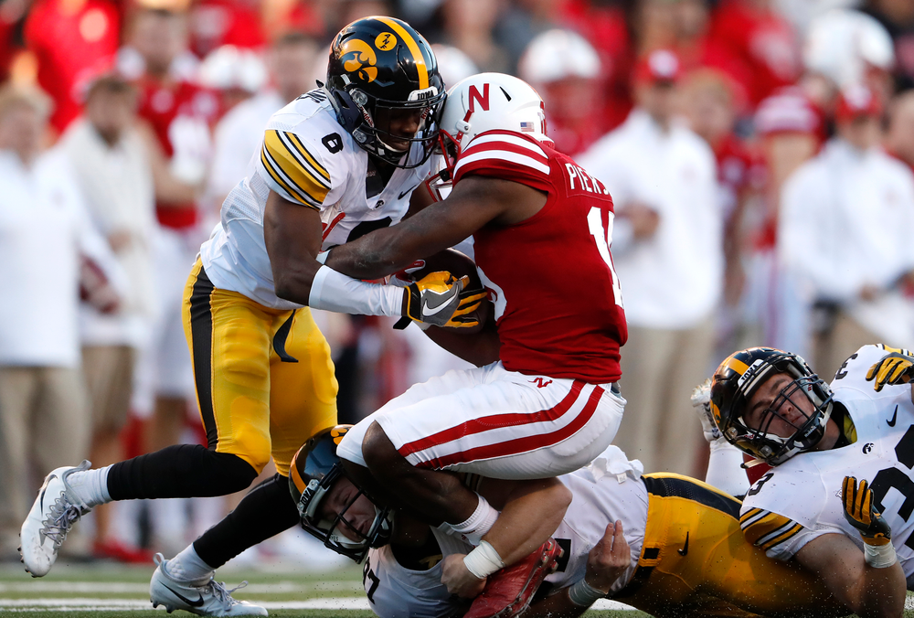 Iowa Hawkeyes defensive back Matt Hankins (8) and long snapper Tyler Kluver (97)