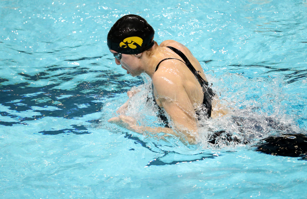 Iowa's Sage Ohlensehlen swims the breaststroke leg of the 200-yard medley relay against the Iowa State Cyclones in the Iowa Corn Cy-Hawk Series Friday, December 7, 2018 at at the Campus Recreation and Wellness Center. (Brian Ray/hawkeyesports.com)