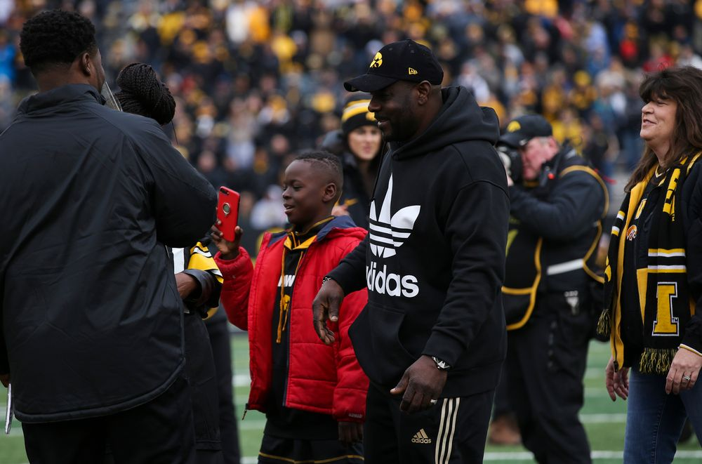 Iowa Hawkeyes linebacker Aaron Mends (31) is greeted by his family during Senior Day ceremonies before a game against Nebraska at Kinnick Stadium on November 23, 2018. (Tork Mason/hawkeyesports.com)