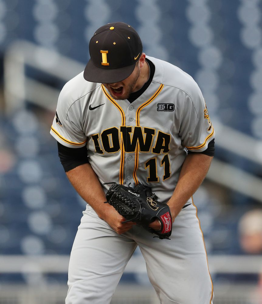 Iowa Hawkeyes Cole McDonald (11) reacts after getting a strikeout to end an inning against the Indiana Hoosiers in the first round of the Big Ten Baseball Tournament Wednesday, May 22, 2019 at TD Ameritrade Park in Omaha, Neb. (Brian Ray/hawkeyesports.com)