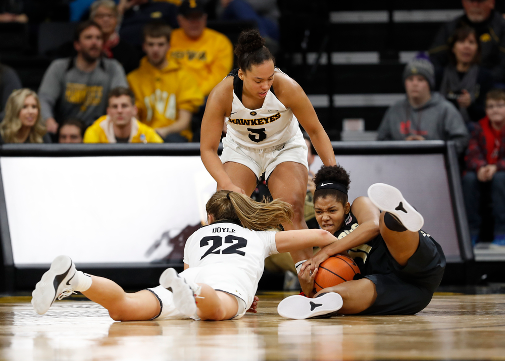 Iowa Hawkeyes guard Kathleen Doyle (22) and guard Alexis Sevillian (5)