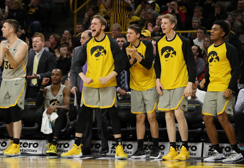 Iowa Hawkeyes forward Riley Till (20), guard Austin Ash (13), and forward Michael Baer (0) against the Nebraska Cornhuskers Sunday, January 6, 2019 at Carver-Hawkeye Arena. (Brian Ray/hawkeyesports.com)