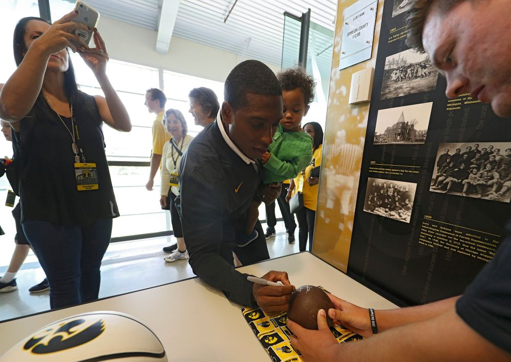 2019 University of Iowa Athletics Hall of Fame inductee Jeremy Allen signs a shot put ball at the University of Iowa Athletics Hall of Fame in Iowa City on Friday, Aug 30, 2019. (Stephen Mally/hawkeyesports.com)