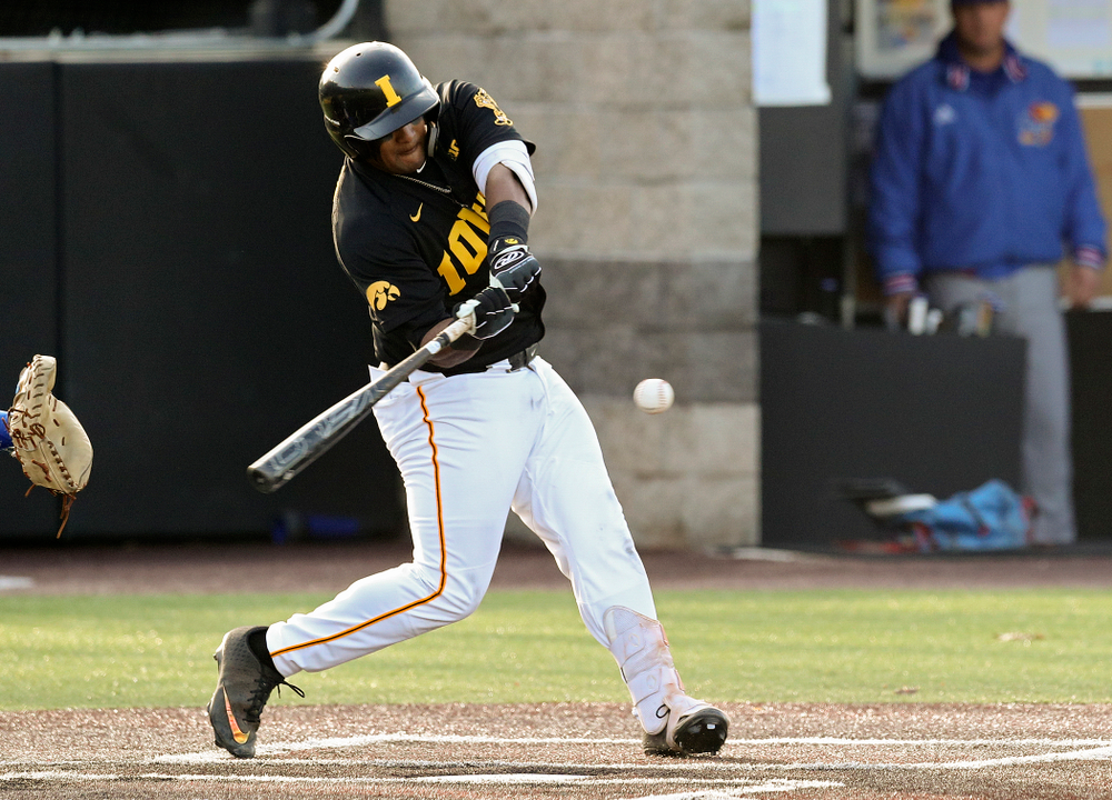 Iowa infielder Izaya Fullard (20) hits a sacrifice fly during the fourth inning of their college baseball game at Duane Banks Field in Iowa City on Tuesday, March 10, 2020. (Stephen Mally/hawkeyesports.com)