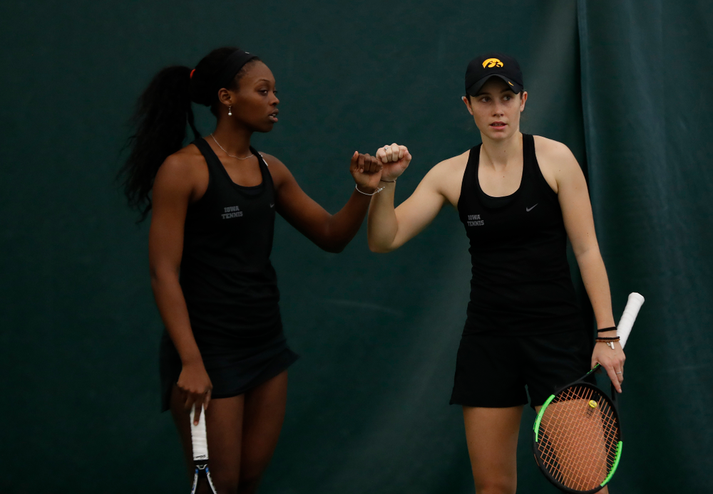 Iowa's Adorabol Huckleby and Elize Van Heuvelen play a doubles match against Marquette