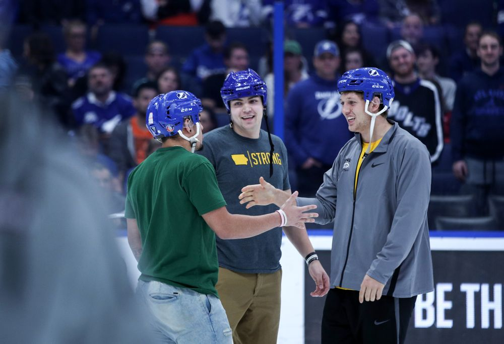 Iowa Hawkeyes tight end T.J. Hockenson (38), quarterback Nate Stanley (4), and defensive back Amani Hooker (27) following an on ice contest against Mississippi State during the first intermission of the Tampa Bay Lightning game Thursday, December 27, 2018 at Amalie Arena. (Brian Ray/hawkeyesports.com)
