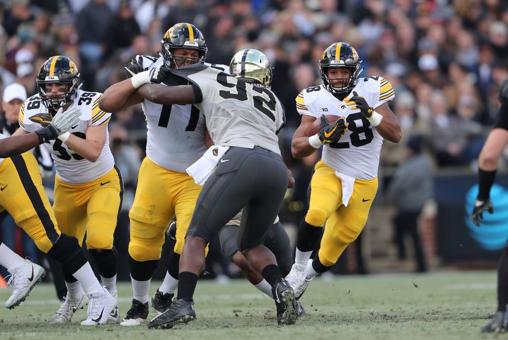 Iowa Hawkeyes running back Toren Young (28) and offensive lineman Alaric Jackson (77) against the Purdue Boilermakers Saturday, November 3, 2018 Ross Ade Stadium in West Lafayette, Ind. (Brian Ray/hawkeyesports.com)