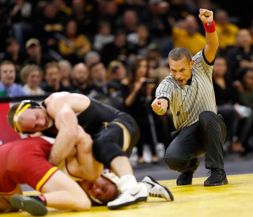 Referee Angel Rivera calls Iowa State's Brady Jennings for stalling