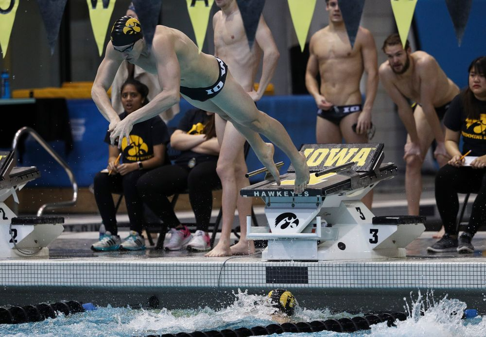 Iowa's Joe Myhre competes in the 400-yard medley relay during a meet against Michigan and Denver at the Campus Recreation and Wellness Center on November 3, 2018. (Tork Mason/hawkeyesports.com)