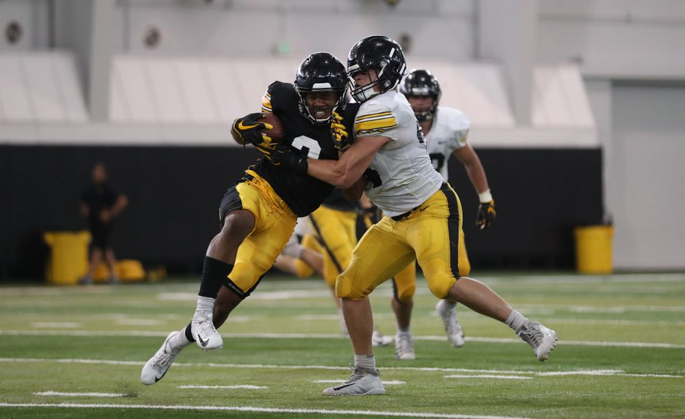 Iowa Hawkeyes wide receiver Tyrone Tracy Jr. (3) and linebacker Seth Benson (44)