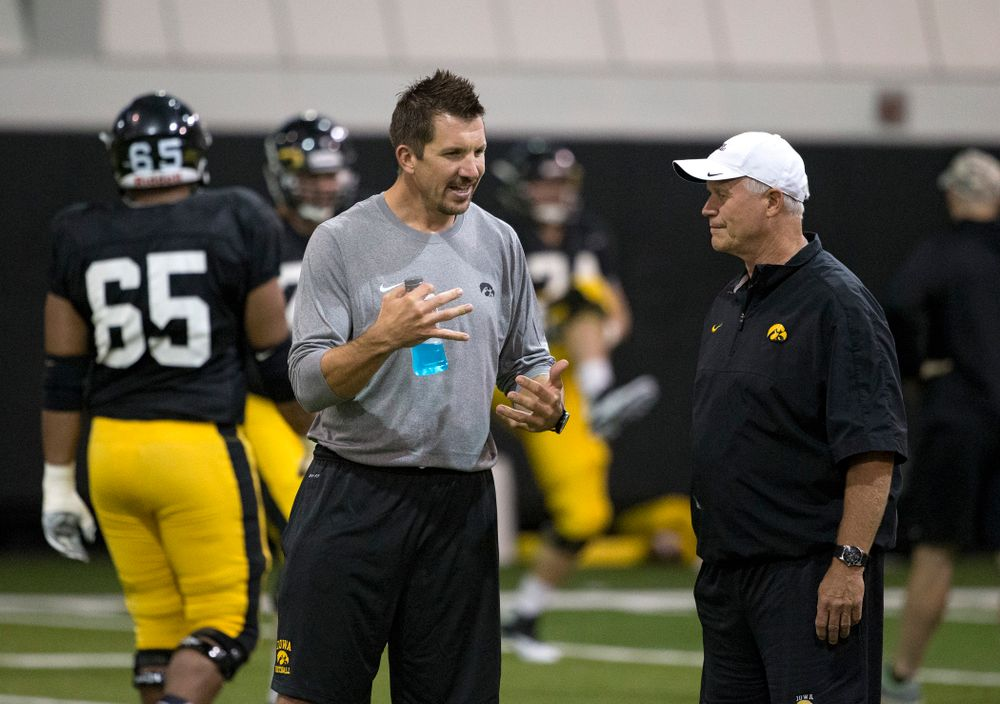 Former Hawkeye  All-American tight end and 11 year NFL veteran Dallas Clark talks with defensive line coach Reese Morgan during the 19th practice of fall camp Wednesday, Aug. 19, 2015 in Iowa City.  (Brian Ray/hawkeyesports.com)