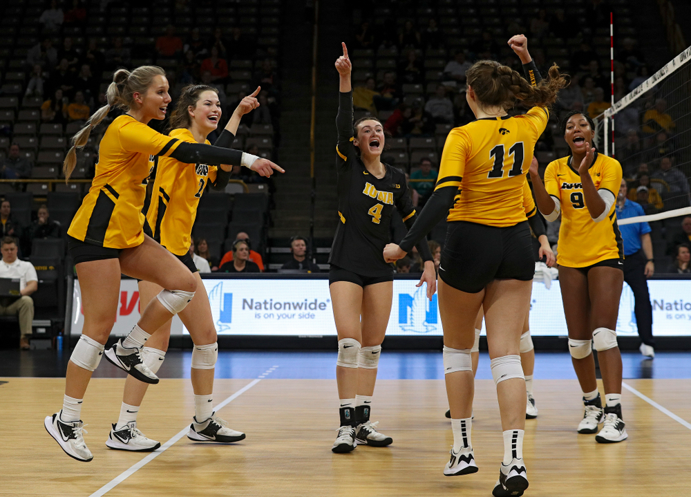Iowa's Maddie Slagle (15), Courtney Buzzerio (2), Halle Johnston (4), Blythe Rients (11), and Amiya Jones (9) celebrate a score during the second set of their match against Illinois at Carver-Hawkeye Arena in Iowa City on Wednesday, Nov 6, 2019. (Stephen Mally/hawkeyesports.com)