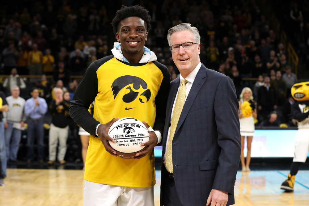 Iowa Hawkeyes forward Tyler Cook (25) receives a ball commemorating his 1,000th career point from Iowa Hawkeyes head coach Fran McCaffery before their game against the Western Carolina Catamounts Tuesday, December 18, 2018 at Carver-Hawkeye Arena. (Brian Ray/hawkeyesports.com)