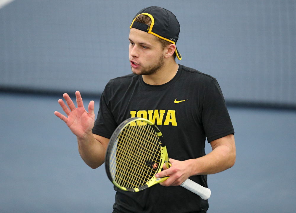 Iowa's Will Davies celebrates a point during their doubles match against Marquette at the Hawkeye Tennis and Recreation Complex in Iowa City on Saturday, January 25, 2020. (Stephen Mally/hawkeyesports.com)