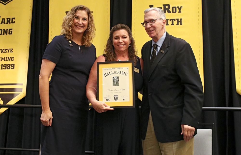 Barb Randall (from left), co-chair of the Varsity Club Advisory Committee, 2019 University of Iowa Athletics Hall of Fame inductee Diane Pohl, and Andy Piro, assistant athletics director and executive director of the Varsity Club, during the Hall of Fame Induction Ceremony at the Coralville Marriott Hotel and Conference Center in Coralville on Friday, Aug 30, 2019. (Stephen Mally/hawkeyesports.com)