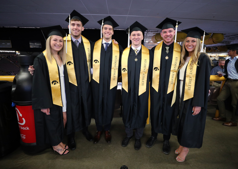 Iowa SwimmingÕs Abbe Schneider, Jack Smith Matt Kamin, Michal Brzus, Tanner Nelson, and Devin Jacobs during the College of Liberal Arts and Sciences spring commencement Saturday, May 11, 2019 at Carver-Hawkeye Arena. (Brian Ray/hawkeyesports.com)