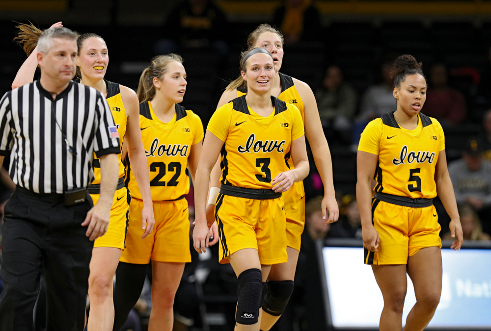 Iowa Hawkeyes forward Amanda Ollinger (43),l guard Kathleen Doyle (22), guard Makenzie Meyer (3), forward Monika Czinano (25), and guard Alexis Sevillian (5) head down the court during the fourth quarter of their game at Carver-Hawkeye Arena in Iowa City on Thursday, January 23, 2020. (Stephen Mally/hawkeyesports.com)