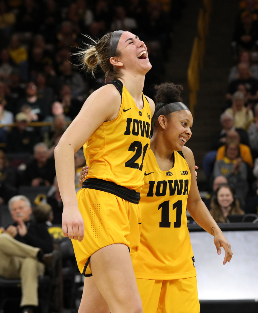Iowa Hawkeyes forward Hannah Stewart (21) and guard Tania Davis (11) during senior day ceremonies following their game against the Northwestern Wildcats Sunday, March 3, 2019 at Carver-Hawkeye Arena. (Brian Ray/hawkeyesports.com)