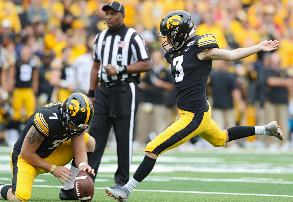 Iowa Hawkeyes place kicker Keith Duncan (3) makes an extra point from the hold of Colten Rastetter (7) during the first quarter of their game at Kinnick Stadium in Iowa City on Saturday, Sep 28, 2019. (Stephen Mally/hawkeyesports.com)