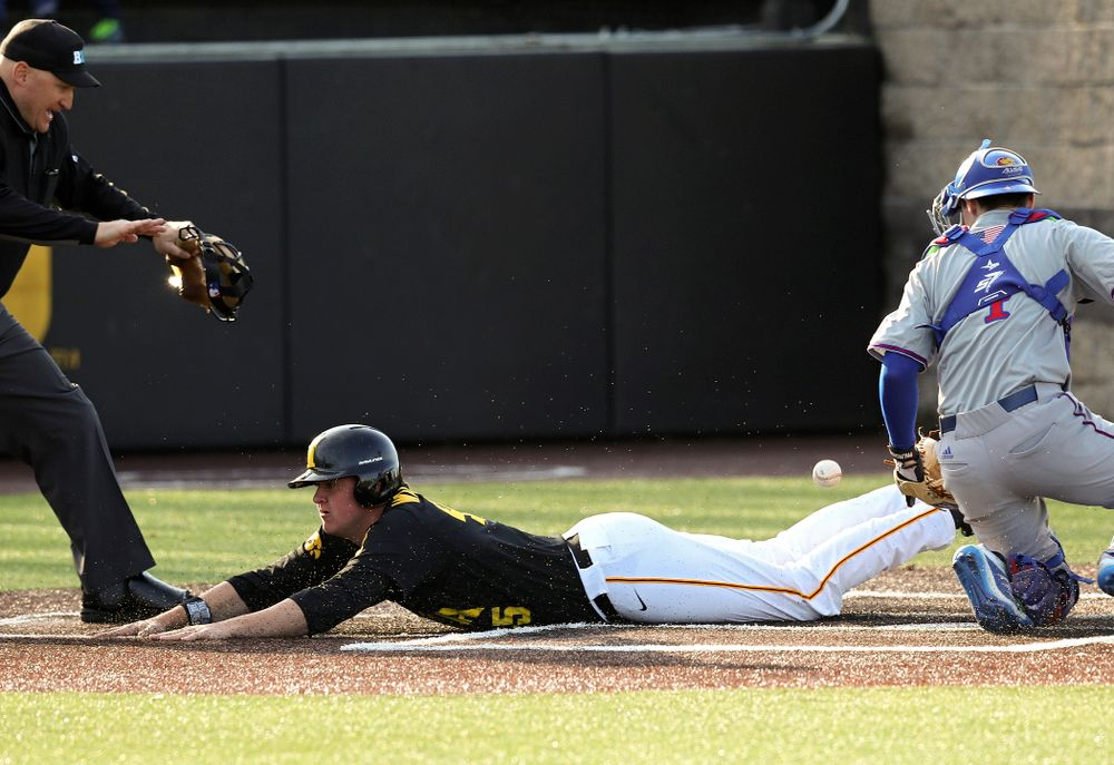 Iowa first baseman Peyton Williams (45) scores a run after a throwing error during the third inning of their college baseball game at Duane Banks Field in Iowa City on Tuesday, March 10, 2020. (Stephen Mally/hawkeyesports.com)