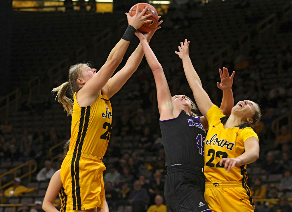 Iowa forward/center Monika Czinano (25) pulls in a rebound as guard Kathleen Doyle (22) tries to reach the ball during the second quarter of their game against Winona State at Carver-Hawkeye Arena in Iowa City on Sunday, Nov 3, 2019. (Stephen Mally/hawkeyesports.com)