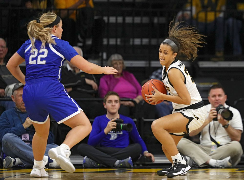 Iowa Hawkeyes guard Gabbie Marshall (24) steals the ball away during the first quarter of their game at Carver-Hawkeye Arena in Iowa City on Saturday, December 21, 2019. (Stephen Mally/hawkeyesports.com)