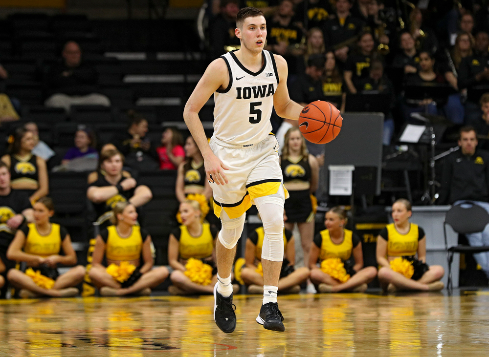 Iowa Hawkeyes guard CJ Fredrick (5) brings the ball down the court during the second half of their game at Carver-Hawkeye Arena in Iowa City on Sunday, Nov 24, 2019. (Stephen Mally/hawkeyesports.com)