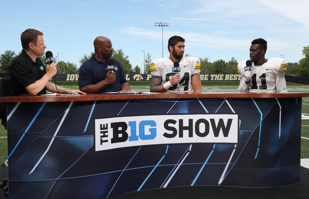 Iowa Hawkeyes defensive end A.J. Epenesa (94) and defensive back Michael Ojemudia (11) on the set of the BTN Tailgate Tour following fall camp Practice No. 16 Tuesday, August 20, 2019 at the Ronald D. and Margaret L. Kenyon Football Practice Facility. (Brian Ray/hawkeyesports.com)