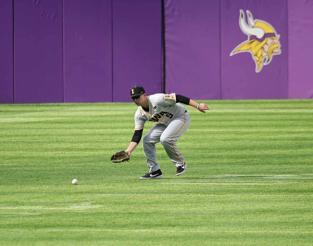 Iowa Hawkeyes outfielder Zeb Adreon (5) fields a ball during the fourth inning of their CambriaCollegeClassic game at U.S. Bank Stadium in Minneapolis, Minn. on Friday, February 28, 2020. (Stephen Mally/hawkeyesports.com)