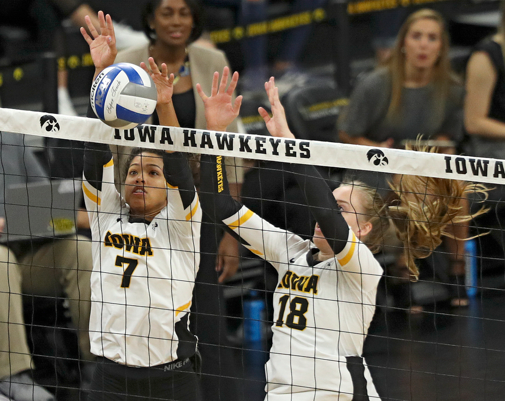 Iowa's Brie Orr (7) gets her hands on a shot as Hannah Clayton (18) looks on during the first set of their volleyball match at Carver-Hawkeye Arena in Iowa City on Sunday, Oct 13, 2019. (Stephen Mally/hawkeyesports.com)