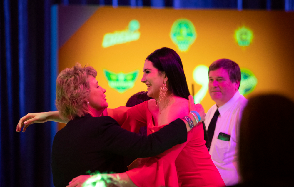 Iowa Hawkeyes forward Megan Gustafson (10) hugs head coach Lisa Bluder after being selected by the Dallas Wings in the second round of the 2019 WNBA Draft Wednesday, April 10, 2019 at Nike New York Headquarters in New York City. (Brian Ray/hawkeyesports.com)