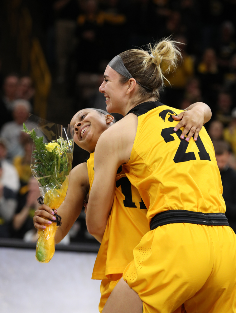 Iowa Hawkeyes guard Tania Davis (11) and forward Hannah Stewart (21) during senior day ceremonies following their game against the Northwestern Wildcats Sunday, March 3, 2019 at Carver-Hawkeye Arena. (Brian Ray/hawkeyesports.com)