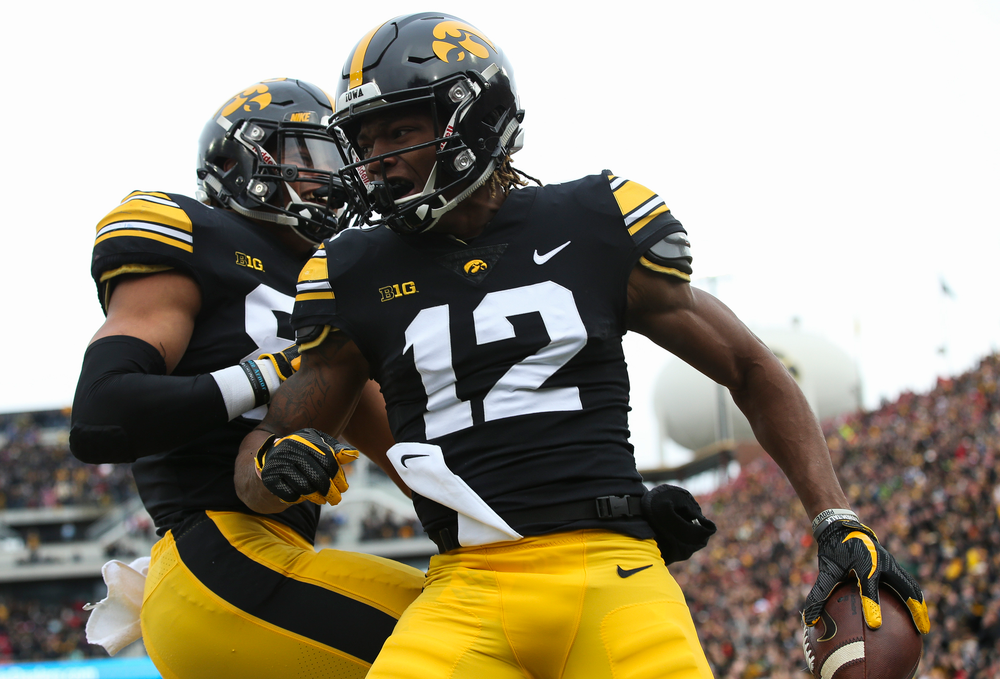 Iowa Hawkeyes wide receiver Brandon Smith (12) celebrates after scoring a touchdown during a game against Nebraska at Kinnick Stadium on November 23, 2018. (Tork Mason/hawkeyesports.com)