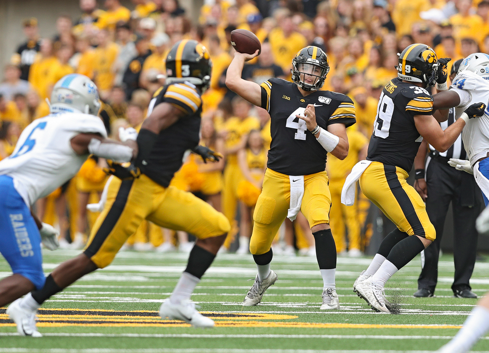 Iowa Hawkeyes quarterback Nate Stanley (4) throws a pass to wide receiver Tyrone Tracy Jr. (3) during third quarter of their game at Kinnick Stadium in Iowa City on Saturday, Sep 28, 2019. (Stephen Mally/hawkeyesports.com)