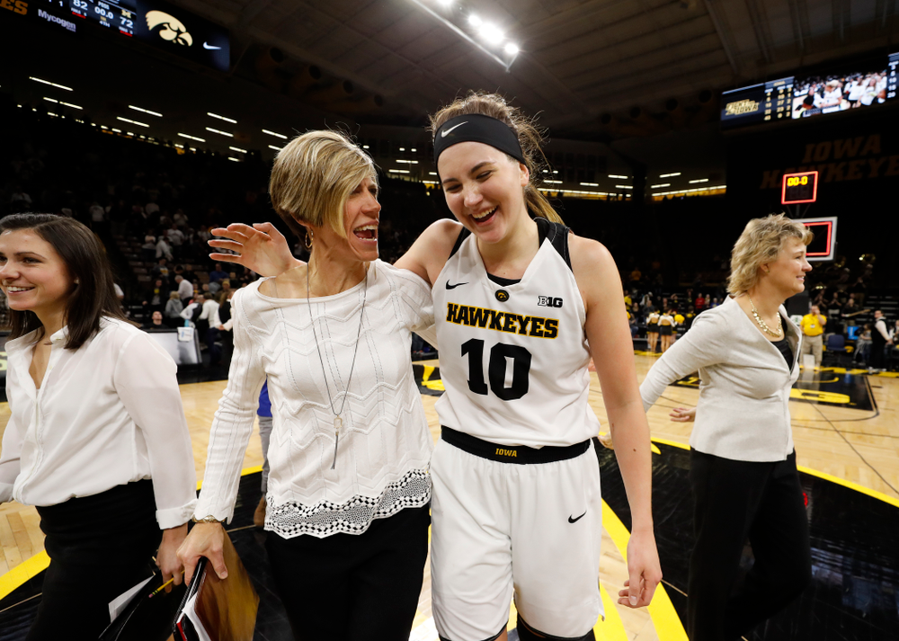 Iowa Hawkeyes associate head coach Jan Jensen and forward Megan Gustafson (10)