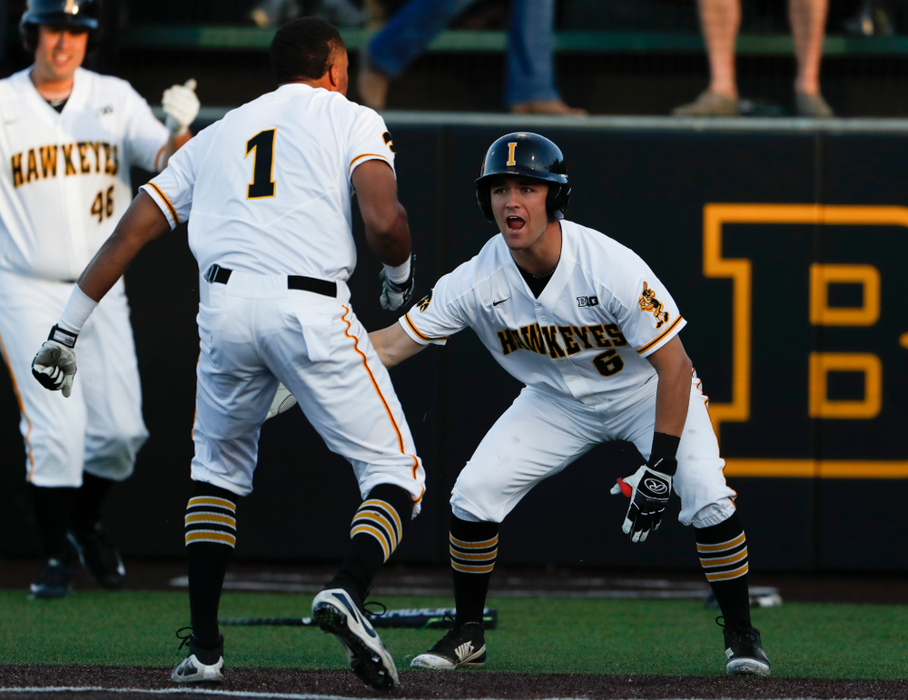 Iowa Hawkeyes third baseman Lorenzo Elion (1) celebrates with outfielder Justin Jenkins (6) against the Michigan Wolverines Friday, April 27, 2018 at Duane Banks Field in Iowa City. (Brian Ray/hawkeyesports.com)