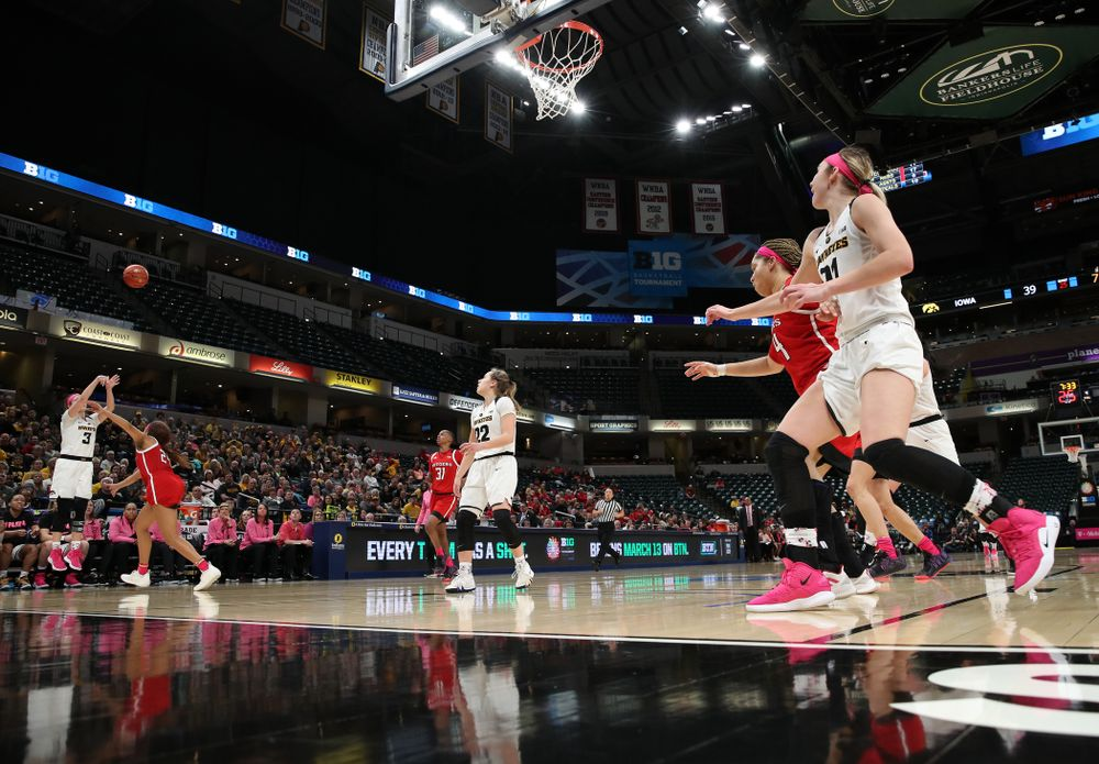 Iowa Hawkeyes guard Makenzie Meyer (3) knocks down a three point basket against the Rutgers Scarlet Knights in the semi-finals of the Big Ten Tournament Saturday, March 9, 2019 at Bankers Life Fieldhouse in Indianapolis, Ind. (Brian Ray/hawkeyesports.com)