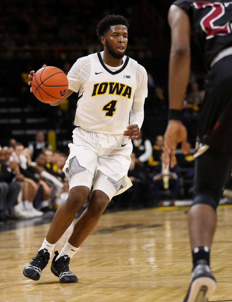 Iowa Hawkeyes guard Isaiah Moss (4) dribbles the ball up court during a game against Guilford College at Carver-Hawkeye Arena on November 4, 2018. (Tork Mason/hawkeyesports.com)